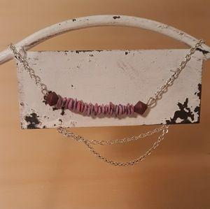Clay bead necklace.